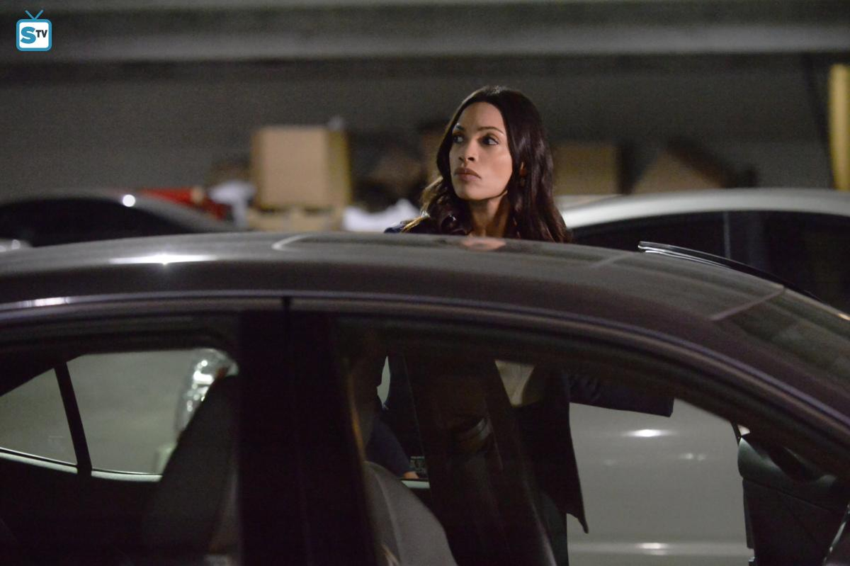 JR waits in a parking garage to meet her supposed blackmailer
