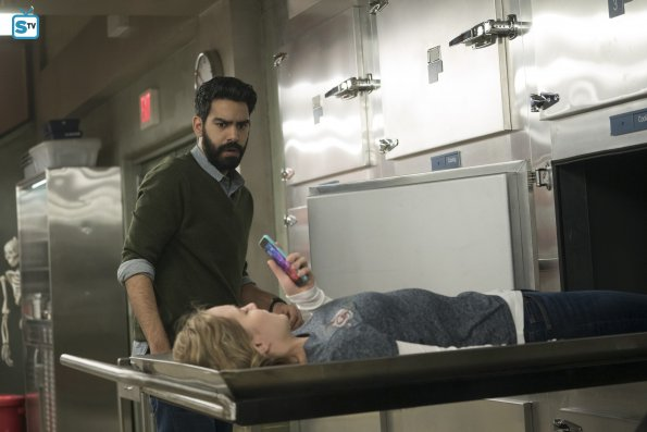 Ravi's a little thrown off to see a teenage girl just chilling in a morgue drawer