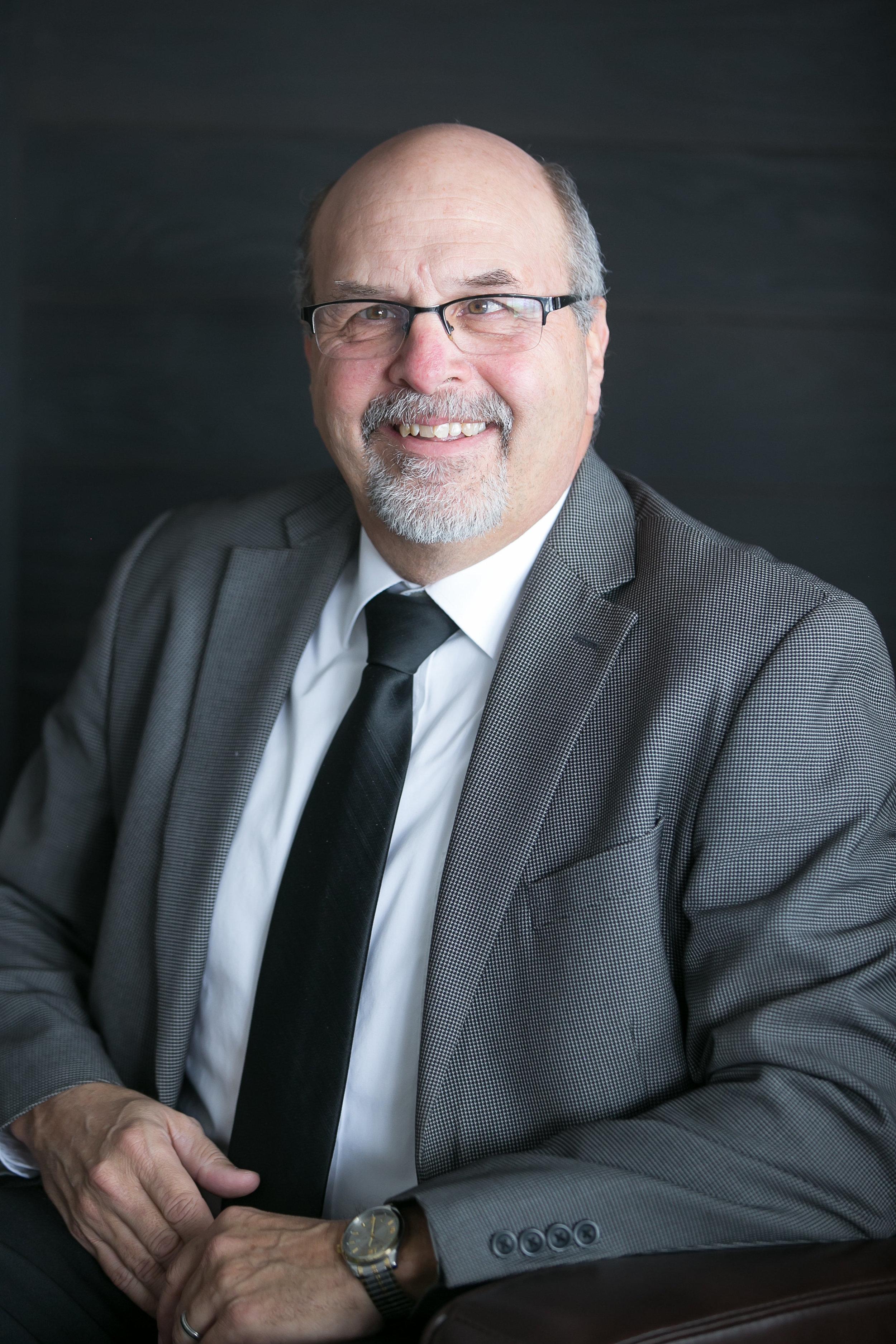 Clark Bates    Associate Minister