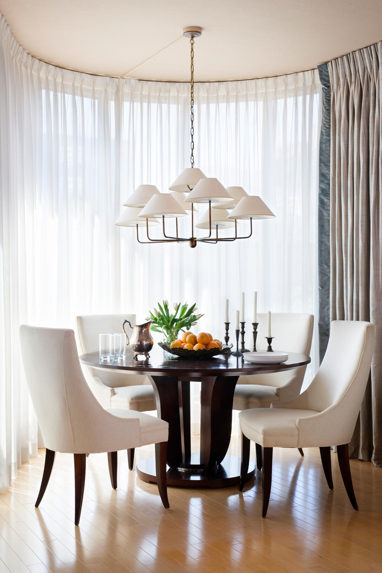 Modern Dining Room Lounge with table and chairs for four and white hanging lamp.
