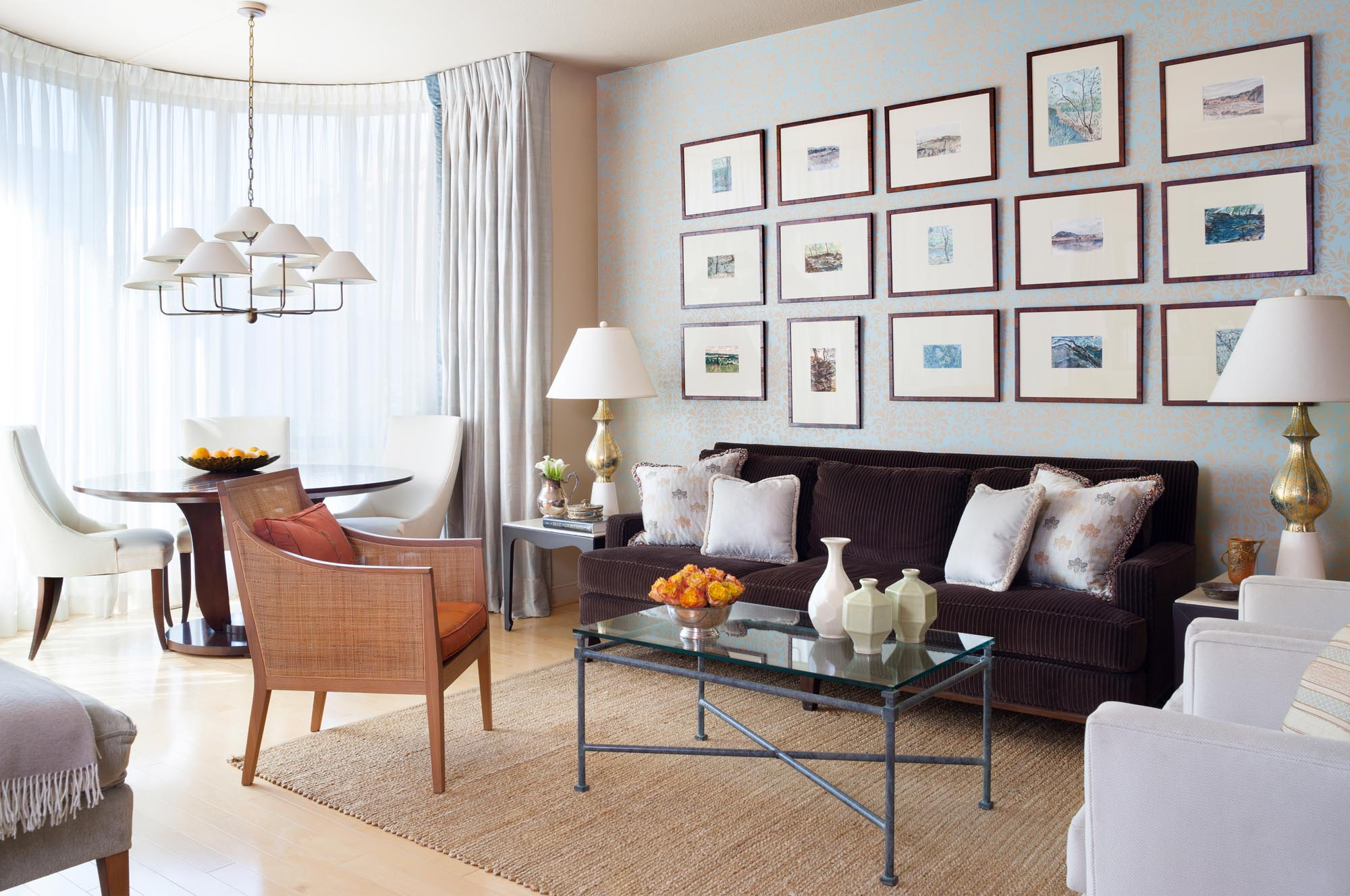 Modern living room interior with picture frames on the wall and brown carpet