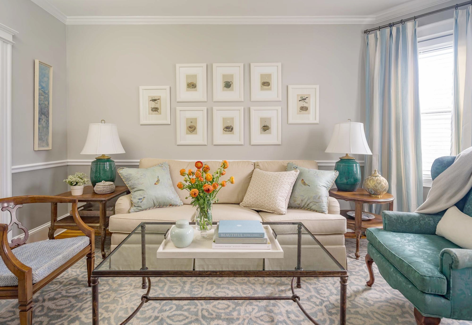 Living Room Design with large couches and glass top coffee table