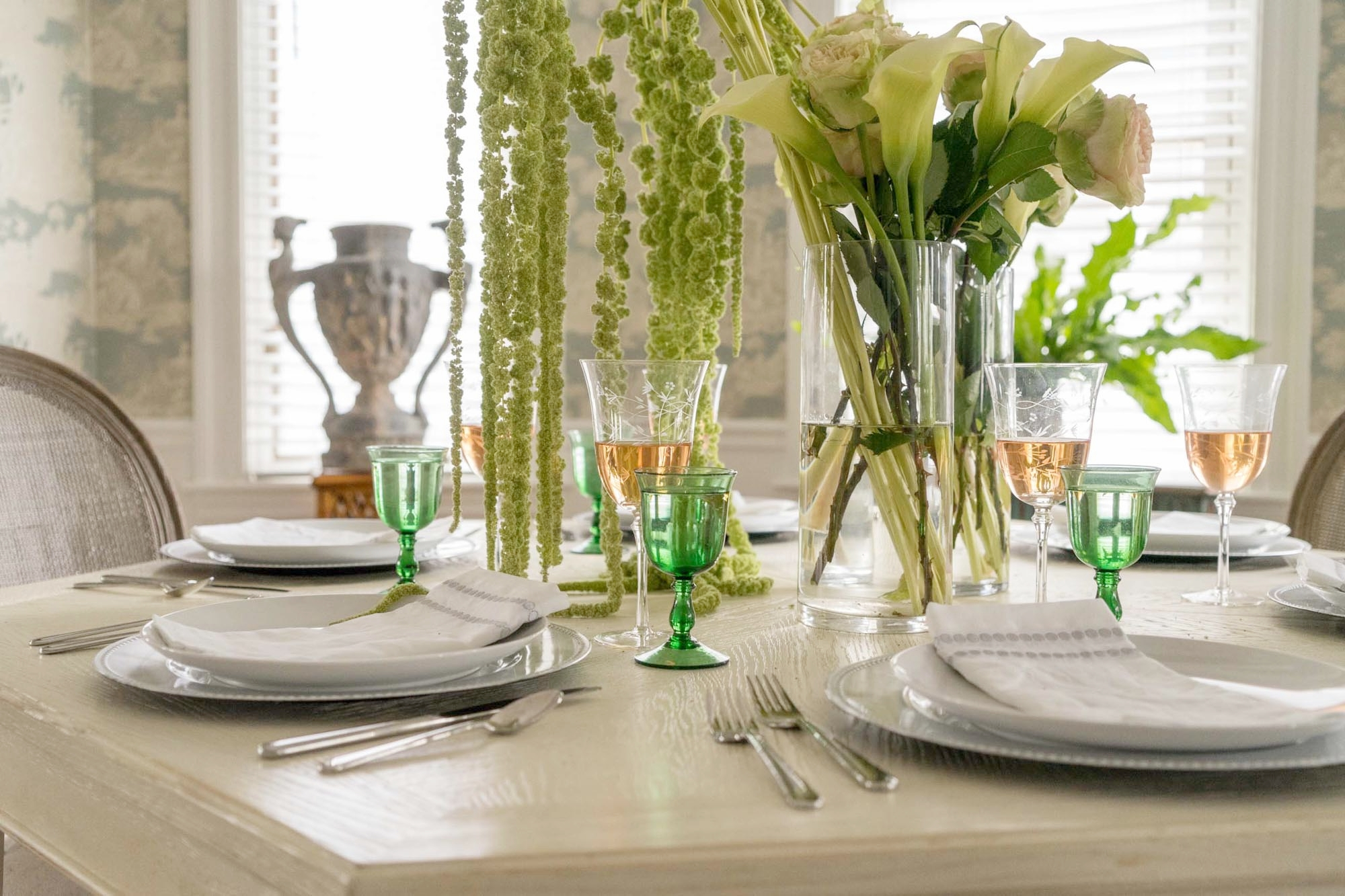 Dining Room Table set up with flowers and glass wine
