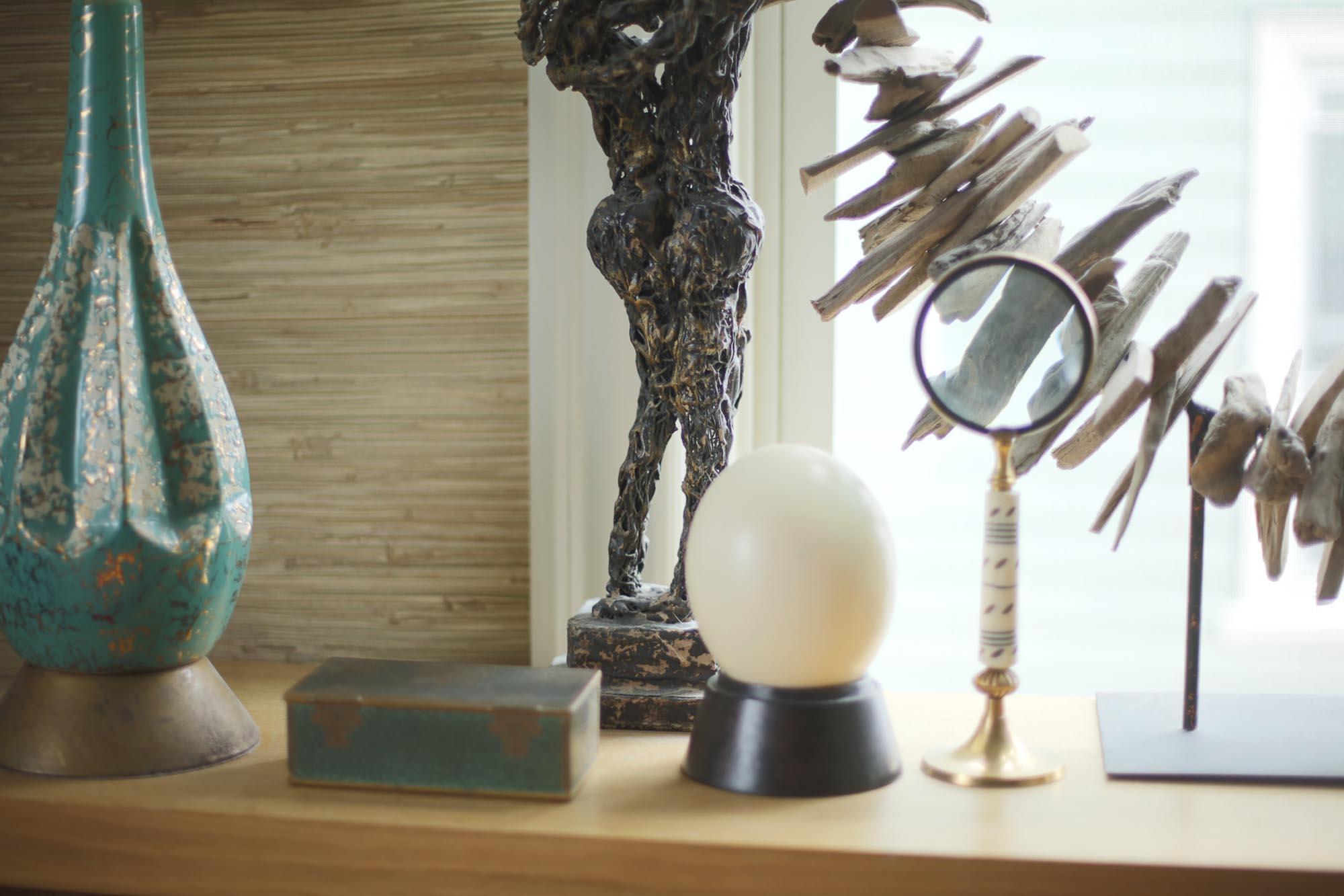 Sculptures resting on a fine wooden dresser