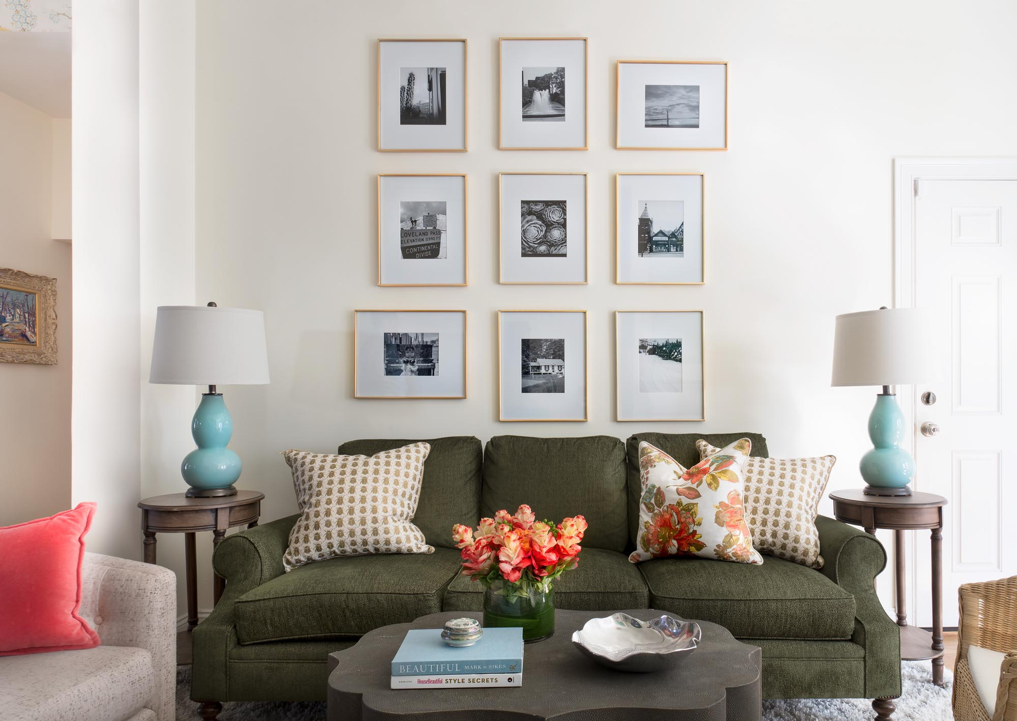 Living room area with framed prints on the wall
