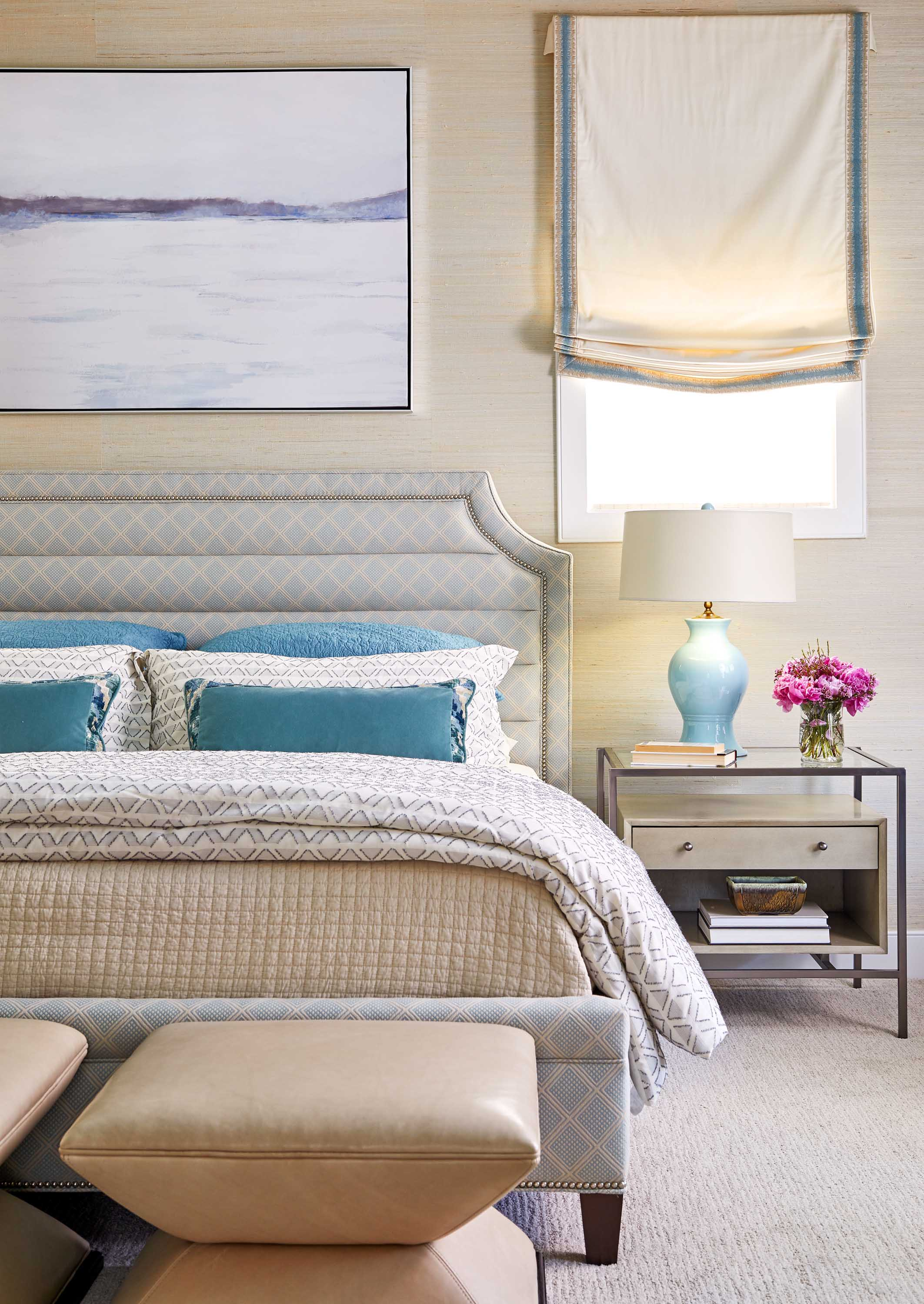 Luxurious bedroom with blue pillows and bedside lamp best of Boston Cambridge DC top-designers Dane Austin Design