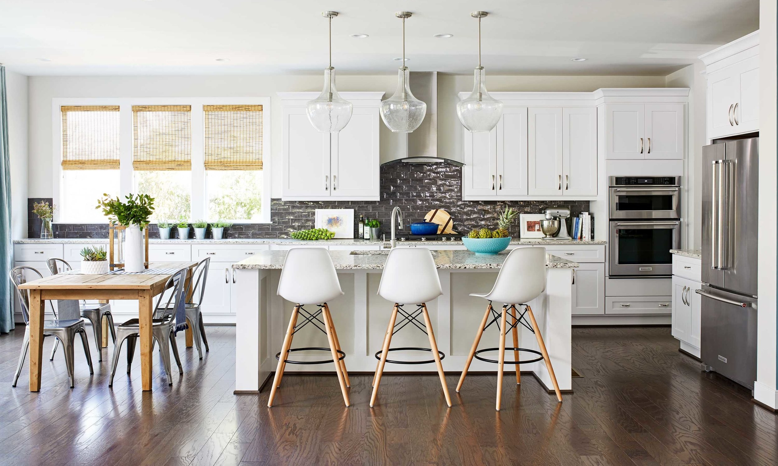 Open kitchen with white cabinets and metal backsplash best of Boston Cambridge DC top-designers Dane Austin Design