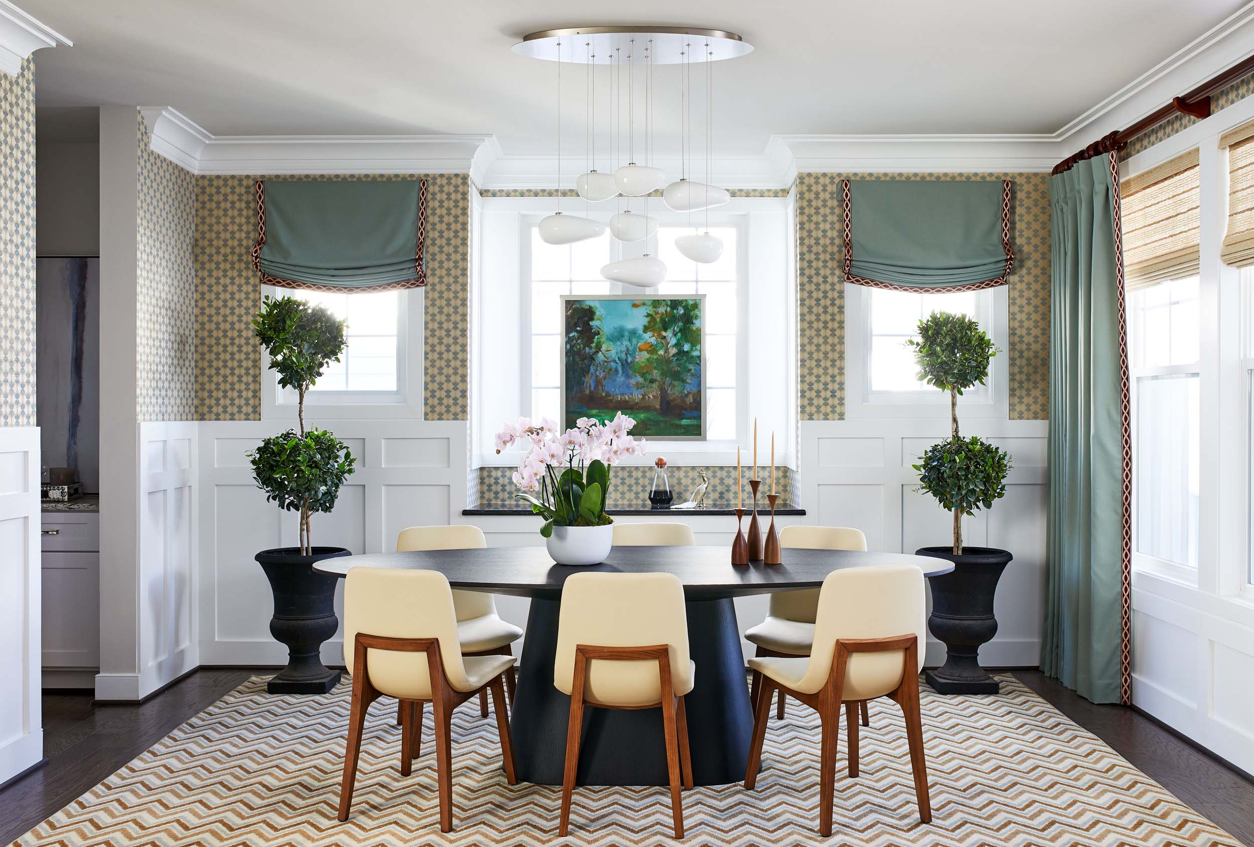 Round dining room table with modern chandelier hanging overhead best of Boston Cambridge DC top-designers Dane Austin Design