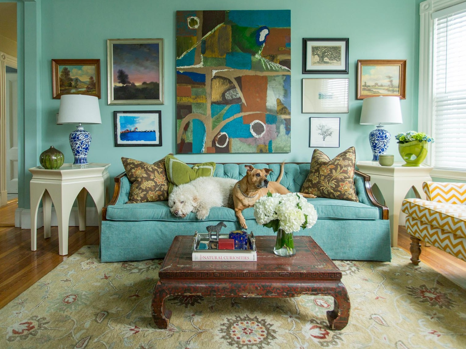 Traditional living space with mint green painted walls