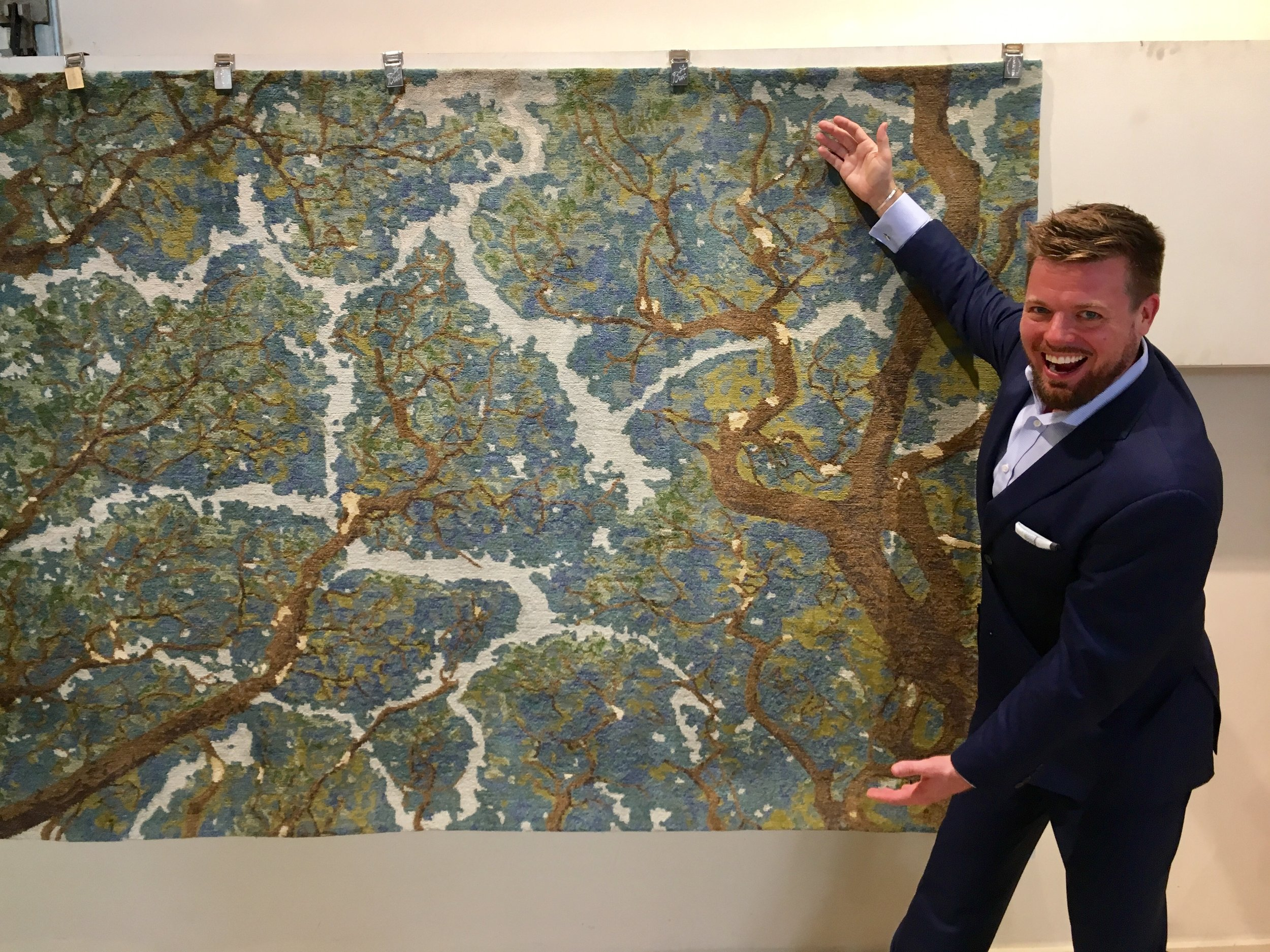 Boston Interior Designer Dane Austin with his new rug design at Landry & Arcari Showroom in Boston, MA.