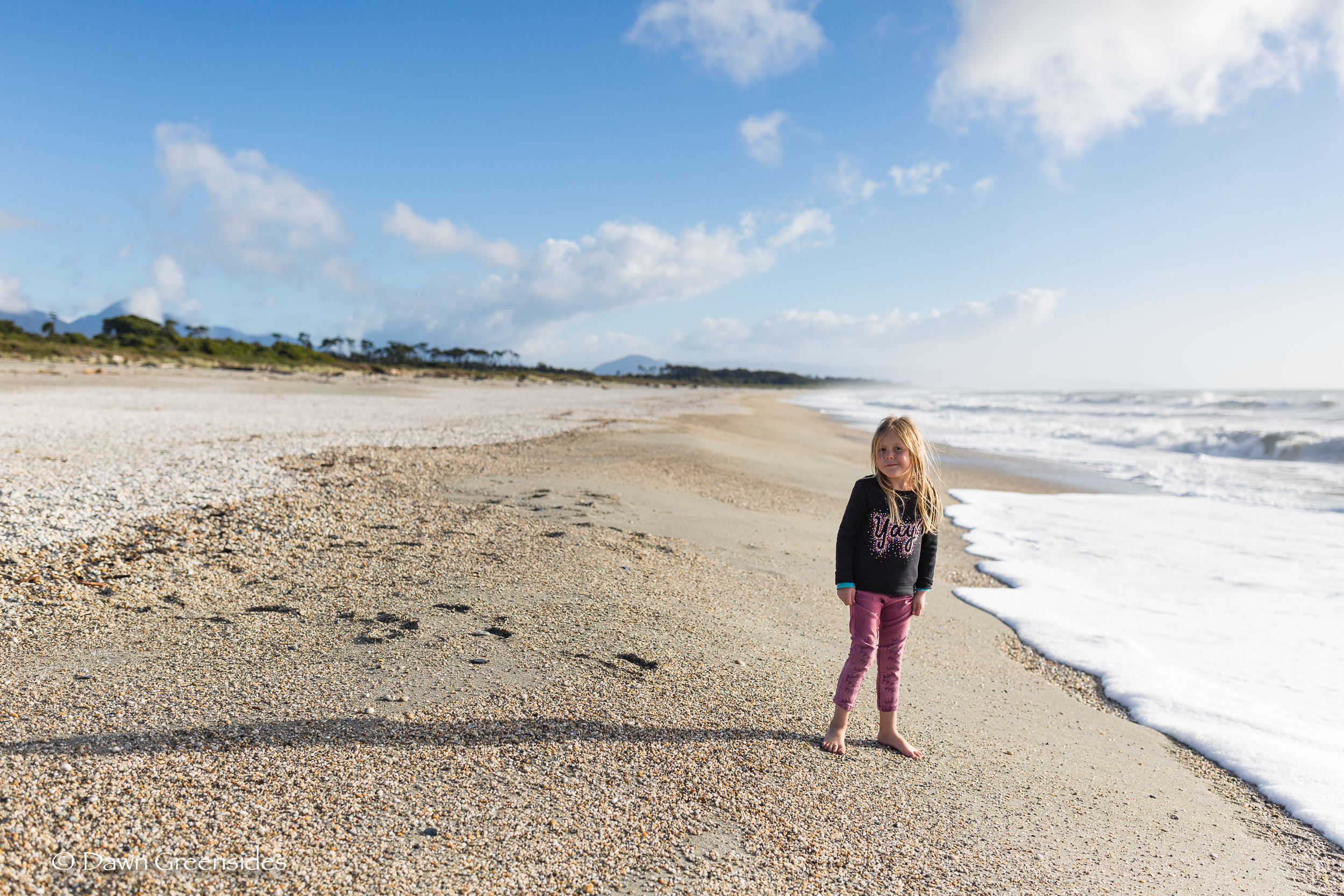 Beautiful daughter on a beautiful beach on the  west coast of the south island  of New Zealand.