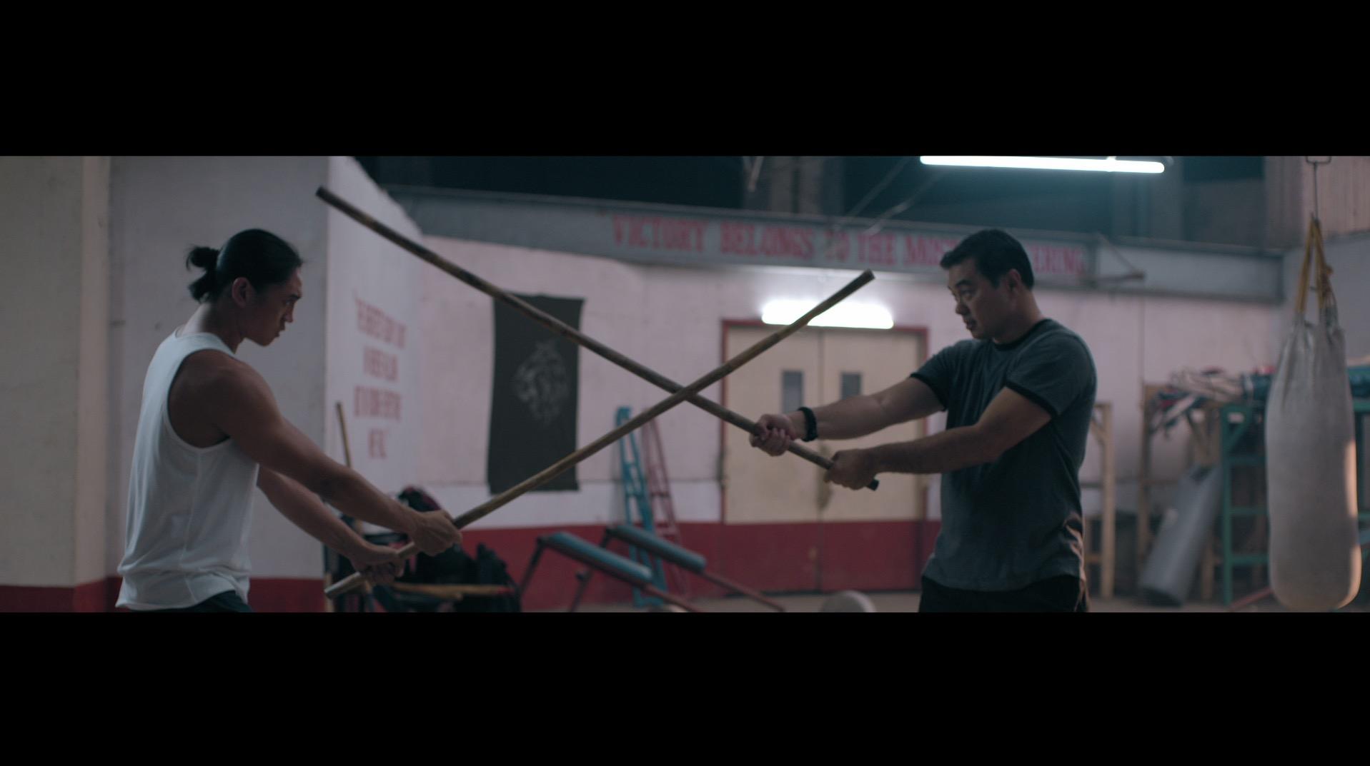 Monsour del Rosario and Ian Ignacio in a scene in The Trigonal