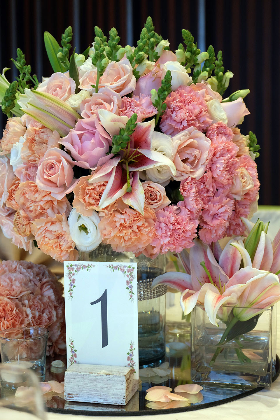 Pretty floral arrangements welcome couple and guests