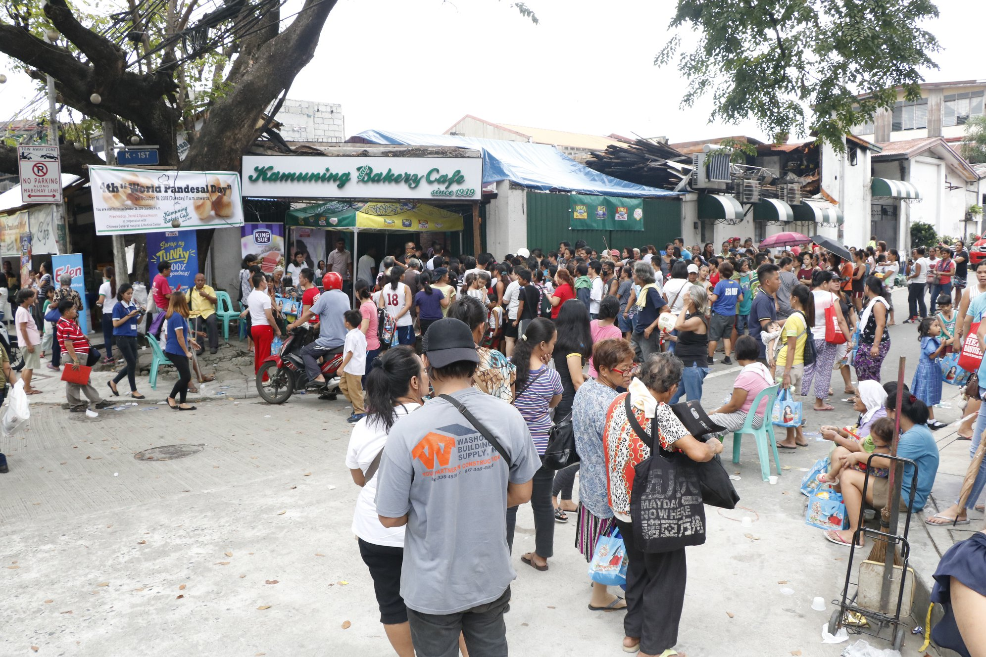 The crowd during the celebration of World Pandesal Day at Kamuning Bakery Cafe where 70,000 pan de sal were given away