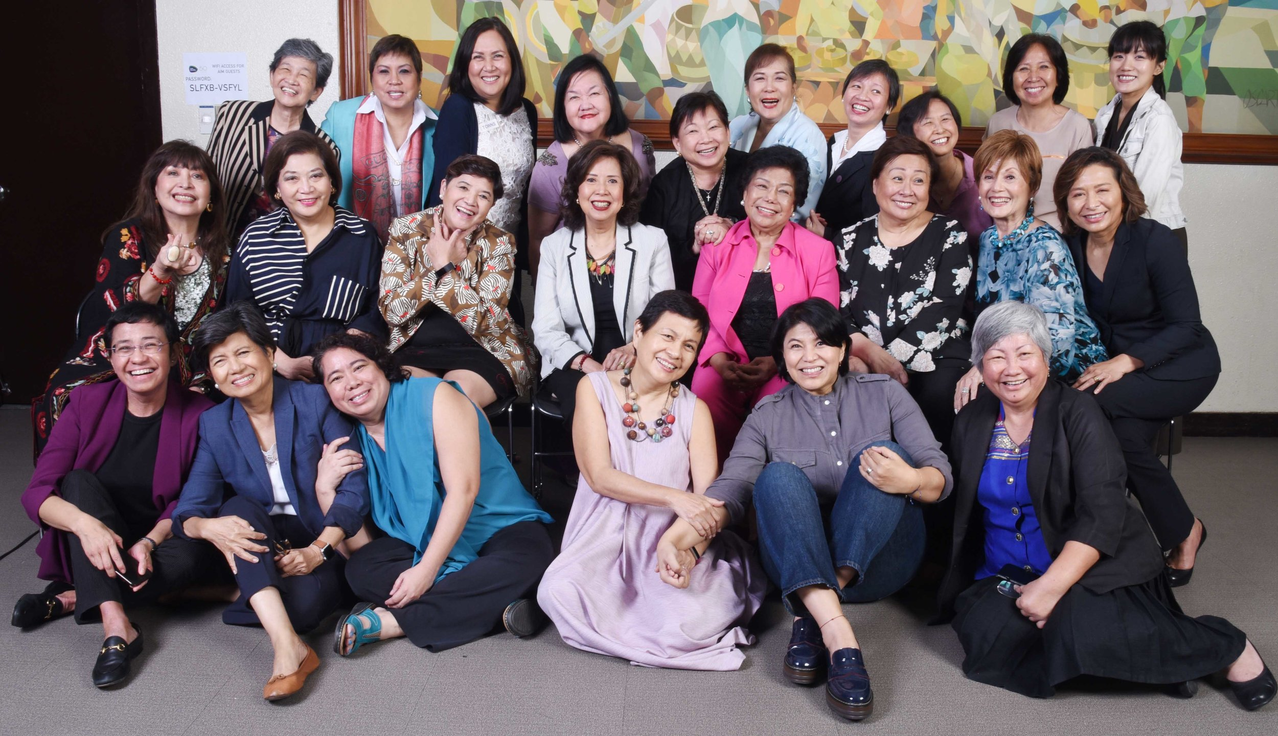 """Part of TOWNS' AWARDEES at the TOWNS TALK@AIM RECENTLY. Front row seated from left, Maria Ressa - 2007 for Broadcast Journalism; Cecilia """"Cheche"""" Lim-Lazaro - 1989 Broadcast journalism; Laura David - 2101 for Oceanography; Cristina """"Nina"""" Lim-Yuson, PhD- 1992 for Education; Therese """"Gang"""" Badoy 2010 - Education; and Lilian F. Patena - 1998 Agriculture (Plant Tissue Culture).  2nd row  from left, Ma. Rosa """"Bing"""" Carreon - 1989 business. Evelyn R. Singson - 1981 Business; June Caridad Lopez -1989 - Psychiatry; Ma. Nieves R. Confessor - 1992 Government Service; Elsa Payumo - 1977 Tourism; and Cecilia """"Ces"""" Orena-Drilon - 2004 Journalism.  Last row from left, Teresita Ang See 1992 - Cultural Integration; Lorna P. Kapunan - 1995 Law; Yolanda V. Ong - 1995 Communications; Imelda Virginia G. Villar, PhD. - 1989 Education; Amelia """"Mel"""" C. Alonzo - 1992 Government Service; Corazon """"Cora"""" P. CLaudio - 1989 Science Technology; Catherine Vistro-Yu - 2007 Education; Ma. Antonette J. Menez - 2001 Science; Virginia Cuevas -1992 Agriculture and Eleonor Pinugu - 2013 Education. (Photo by Mandy Navaser"""