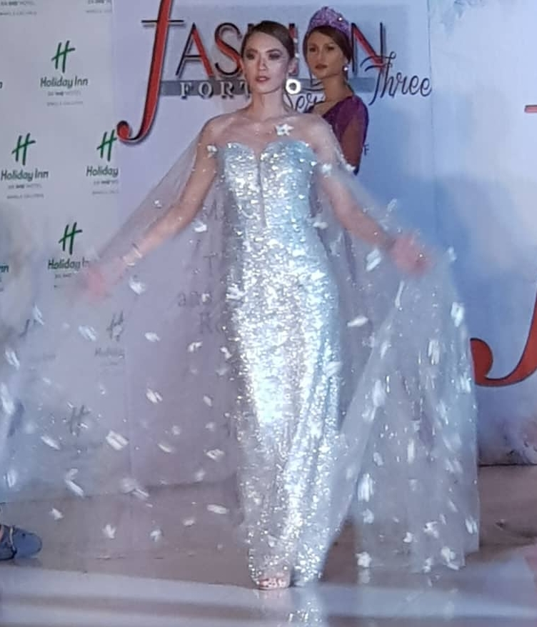 Marianne Martin creation of white shimmering gown
