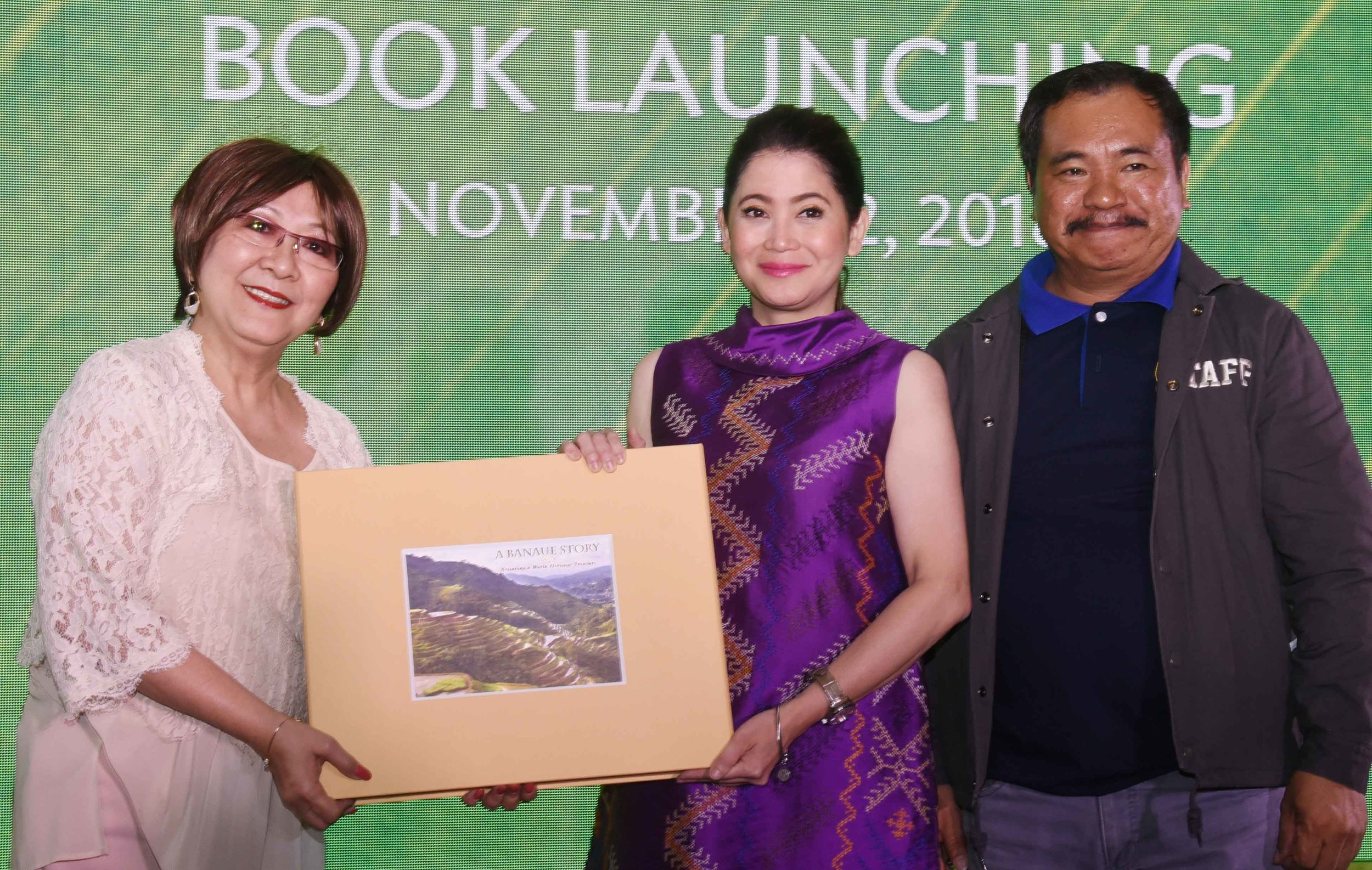 "Dr. Milagros O. How presenting the ""A Banaue Story"" book to special guest during the launch, DOT Secretary Bernadette Romulo-Puyat     together with Banaue Mayor  Jerry U. Dalipog"