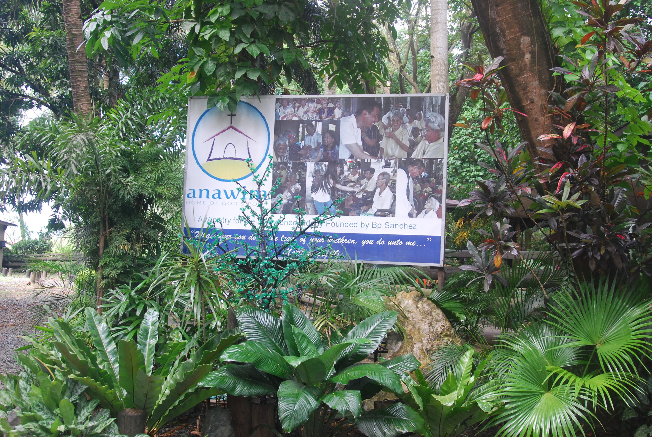 A billboard at the entrance identifies the place as a sanctuary for abandoned elderlies