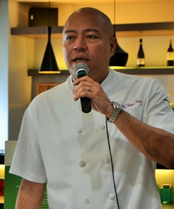 Tito Chef speaks before an audience during a food fest