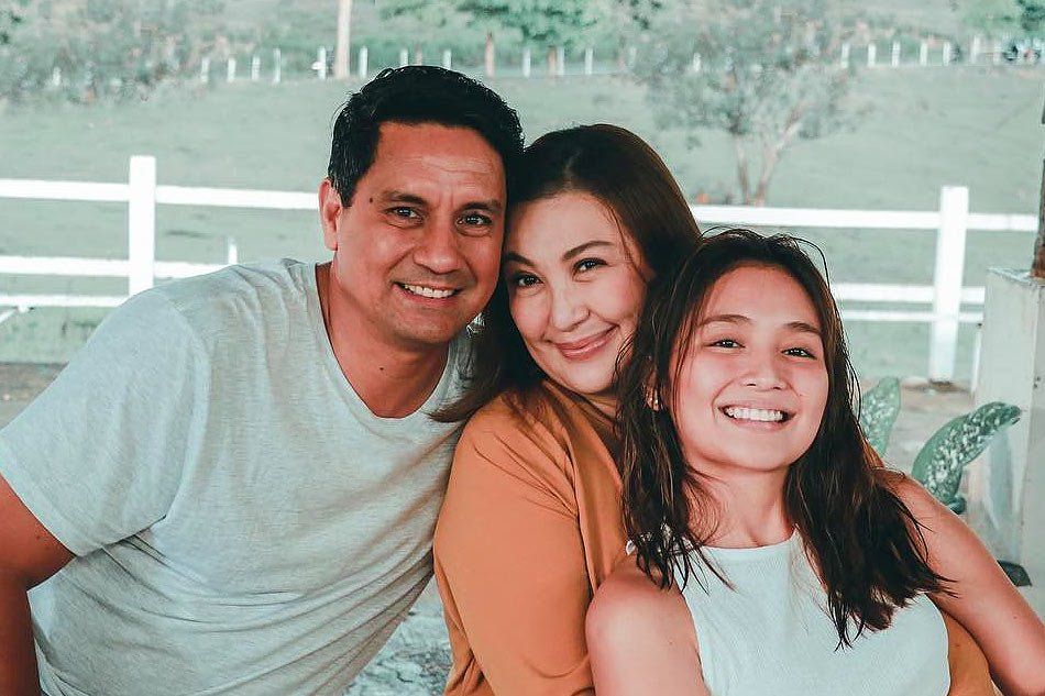 """""""Three Words to Forever"""" reunites former sweethearts Richard Gomez and Sharon Cuneta. Kathryn Bernardo plays the couple's daughter in the movie."""
