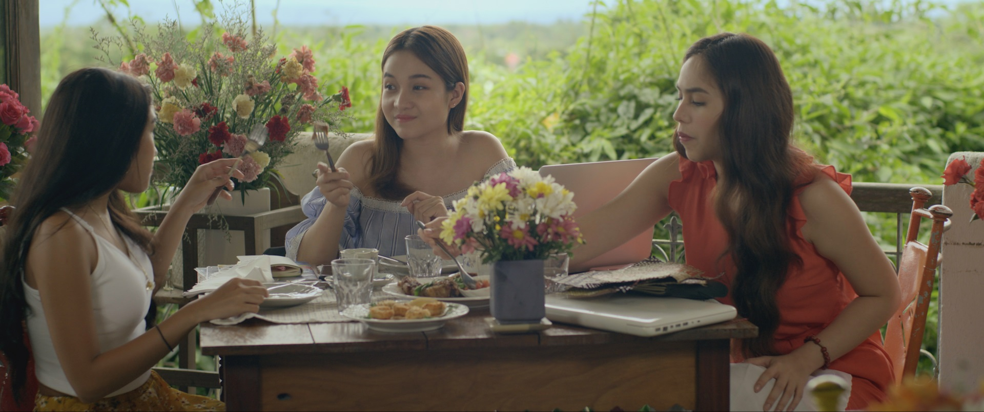 Three women enjoying breakfast in Samar