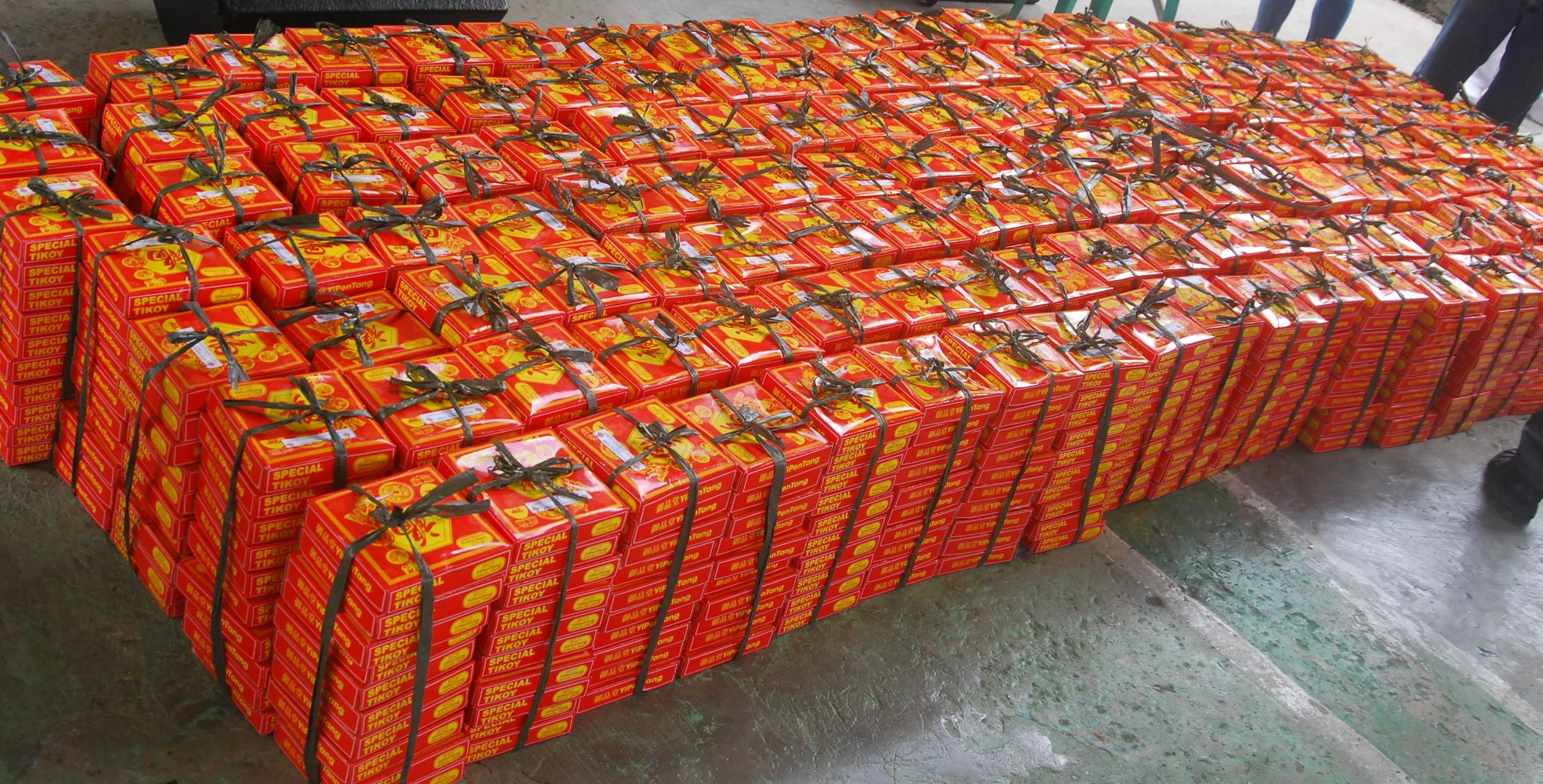 Some 10,000 pieces of tikoy were distributed to the residents of Camarin and Barracks in north Caloocan City
