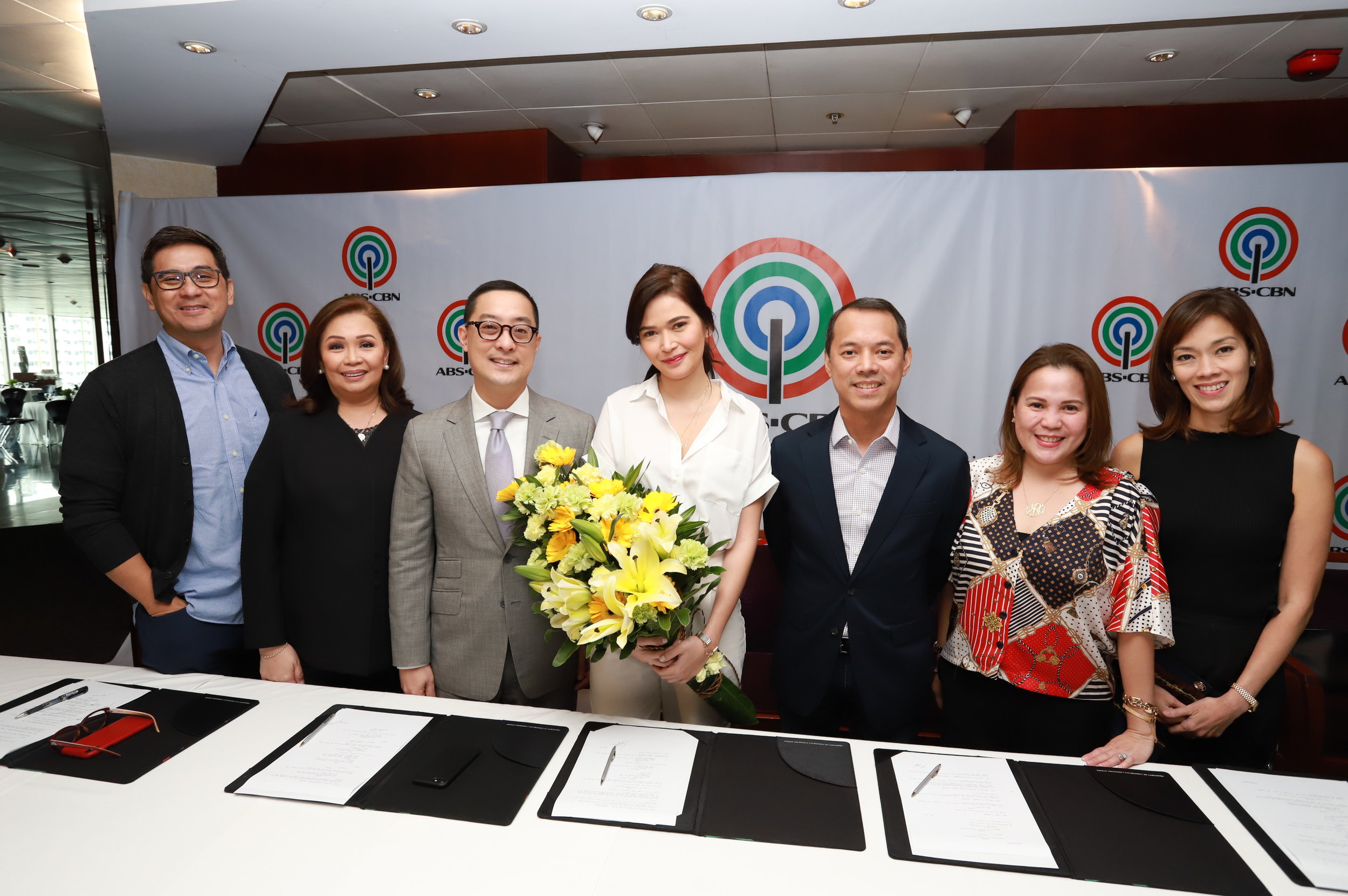 Bela Padilla with ABS-CBN executives.JPG