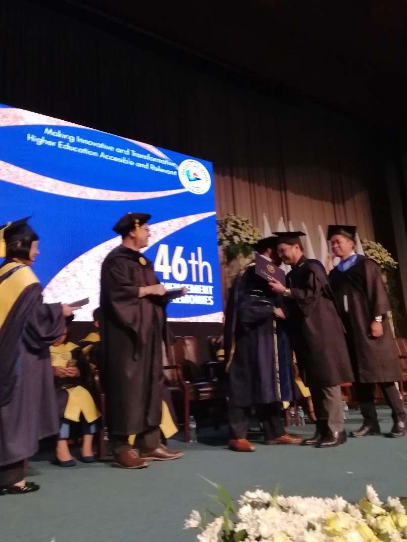 Arnell Ignacio receives diploma at the graduation ceremenoy of University of Makati