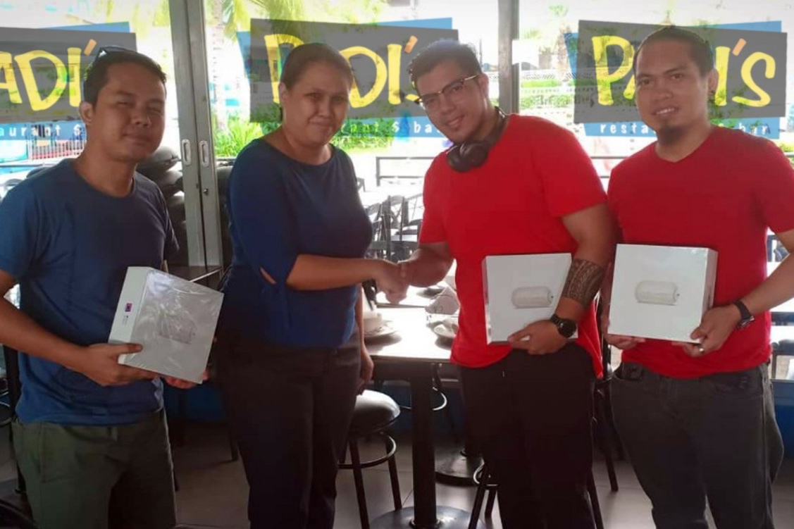 The Happy Hour Barkada Treat 2018 winners with their pocket drones, From left, Rodel Carulasan, Padi's Point assistant marketing manager Julie Ann Gatchalian, Karl Devoe Guidaya and Rommel Longatang
