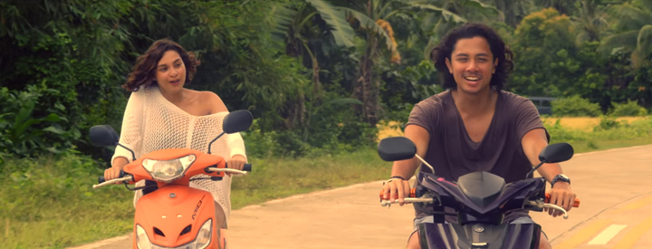 A scen from Mr. & Mrs. Cruz: Gela (Ryza Cenon) and Raffy (JC Santos) ride bikes around El Nido