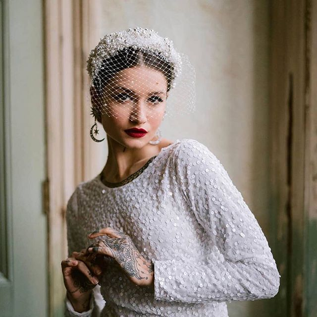 Our long time fave piece 'Kristina' looking beyond stunning in this  shoot for @rocknrollbride featuring their beautiful dress collab with @littlemistressuk 💕 ⠀⠀ If you're planning your wedding day look and want some unique headwear drop me a line. I can customize any existing design or create a bespoke one just for you! Working with brides to design their perfect piece is the best part of my job 😊 ⠀⠀ Thank you to all the talented team below for these jaw dropping images! .……… Photos by @devlinphotos Styling by: @thebijoubride & @mrandmrsunique Hair by @joloveshair  make up by @lou_seymourmua Model @elisabettasoskic. Assistant: @samluckphoto. ⠀⠀ #bridalheadwear #bridalheadpiece #bridalheadband #beading #handmade #millinery #modernbride #bridalstyle #lizziemcquade #bespokebridal #engaged #bridetobe #rocknrollbridexlittlemistressuk