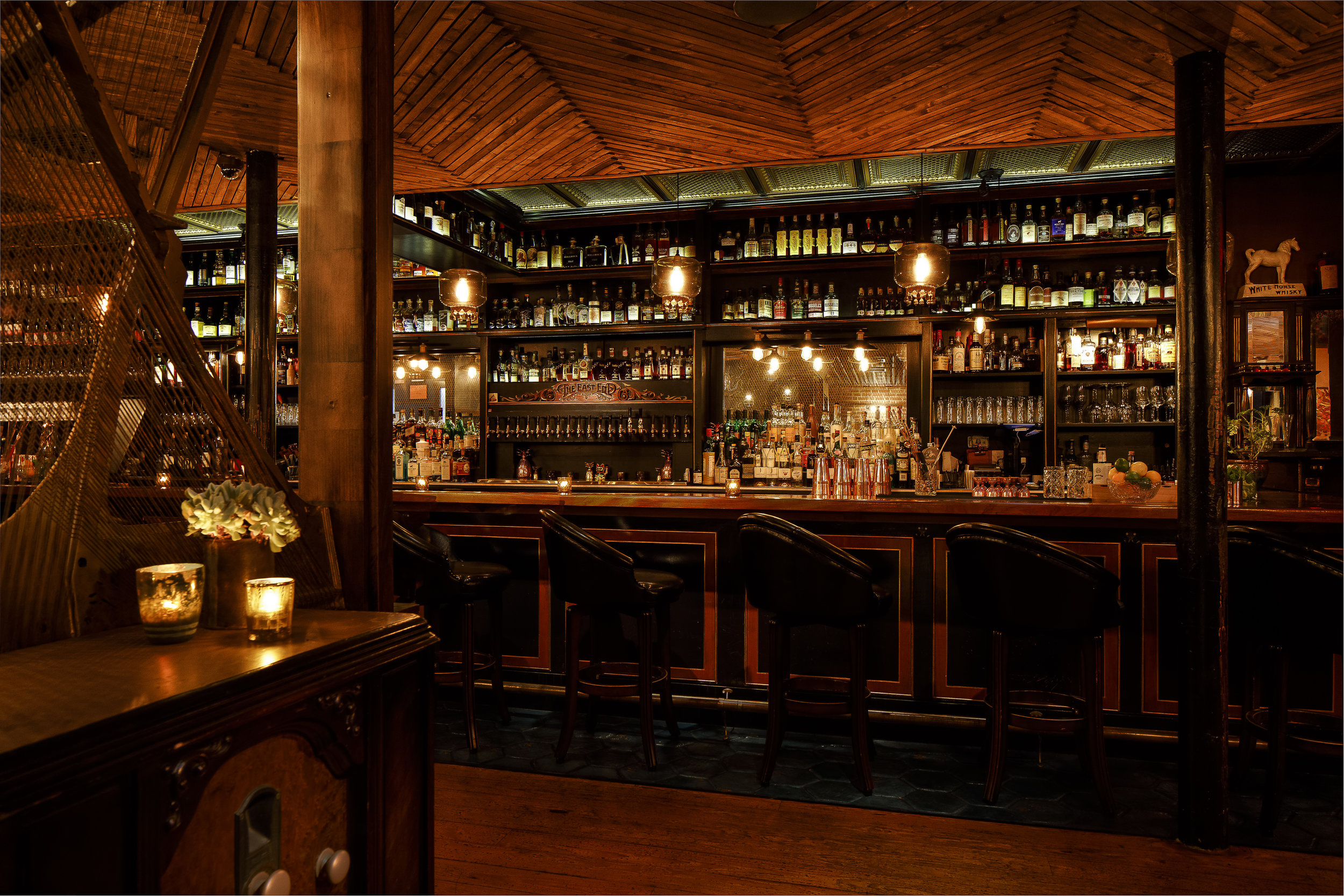 East End has Victorian whiskey bar ambiance with tin ceilings and rich velvet drapes, plus a bar highlighting an extensive spirits selection