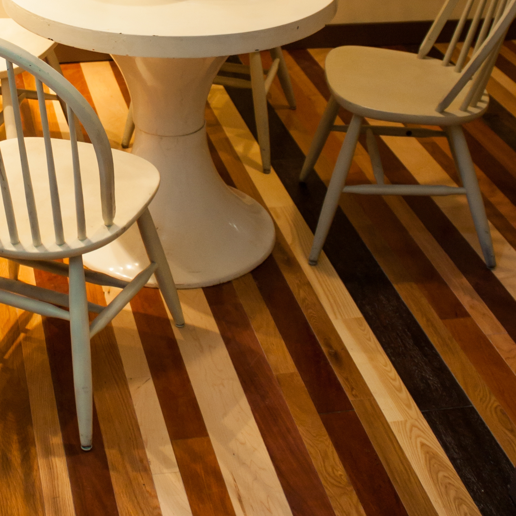 A variety of stains and plank widths creates a floor with visual interest and texture.