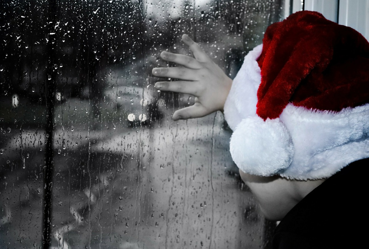 child looking out window to rain family mediation at Christmas.jpg