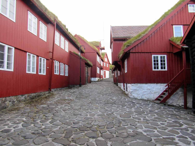 denmark-faroe-islands-streymoy-torshavn-tinganes-streets-cobblestone-red-white-houses-buildings.jpg