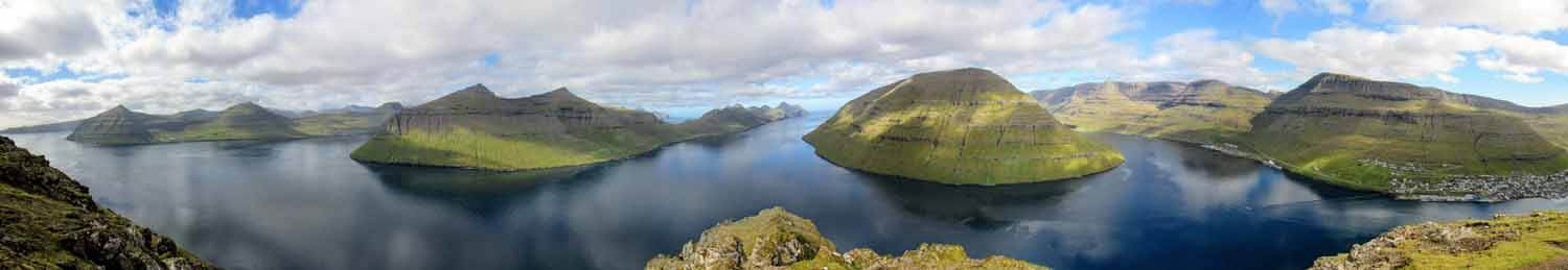 Stunning view from the Klakkur Peak accessible from the town of Klaksvik (Right). From Left to Right:   Eysturoy,   Kalsoy,   Kunoy & Bordoy  Islands.