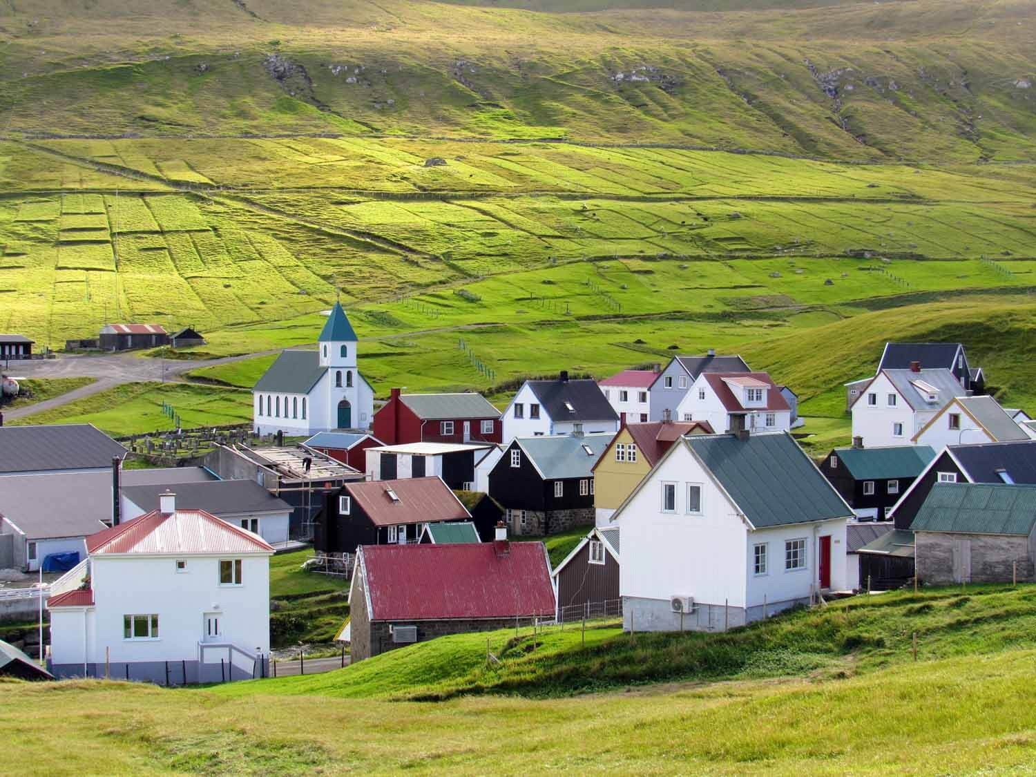 denmark-faroe-islands-eysturoy-eidi-village-green-fields.jpg