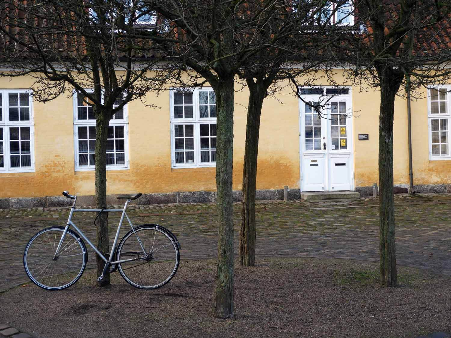 denmark-copenhagen-bicycle-trees-yellow-house.JPG