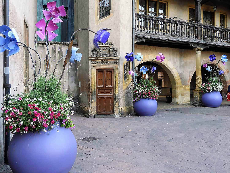 france-colmar-city-art-colored-flower-pots.jpg