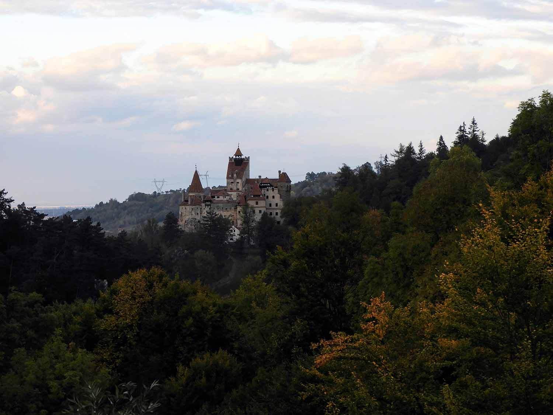 romania-bran-castle-distant-view-hilltop.jpg