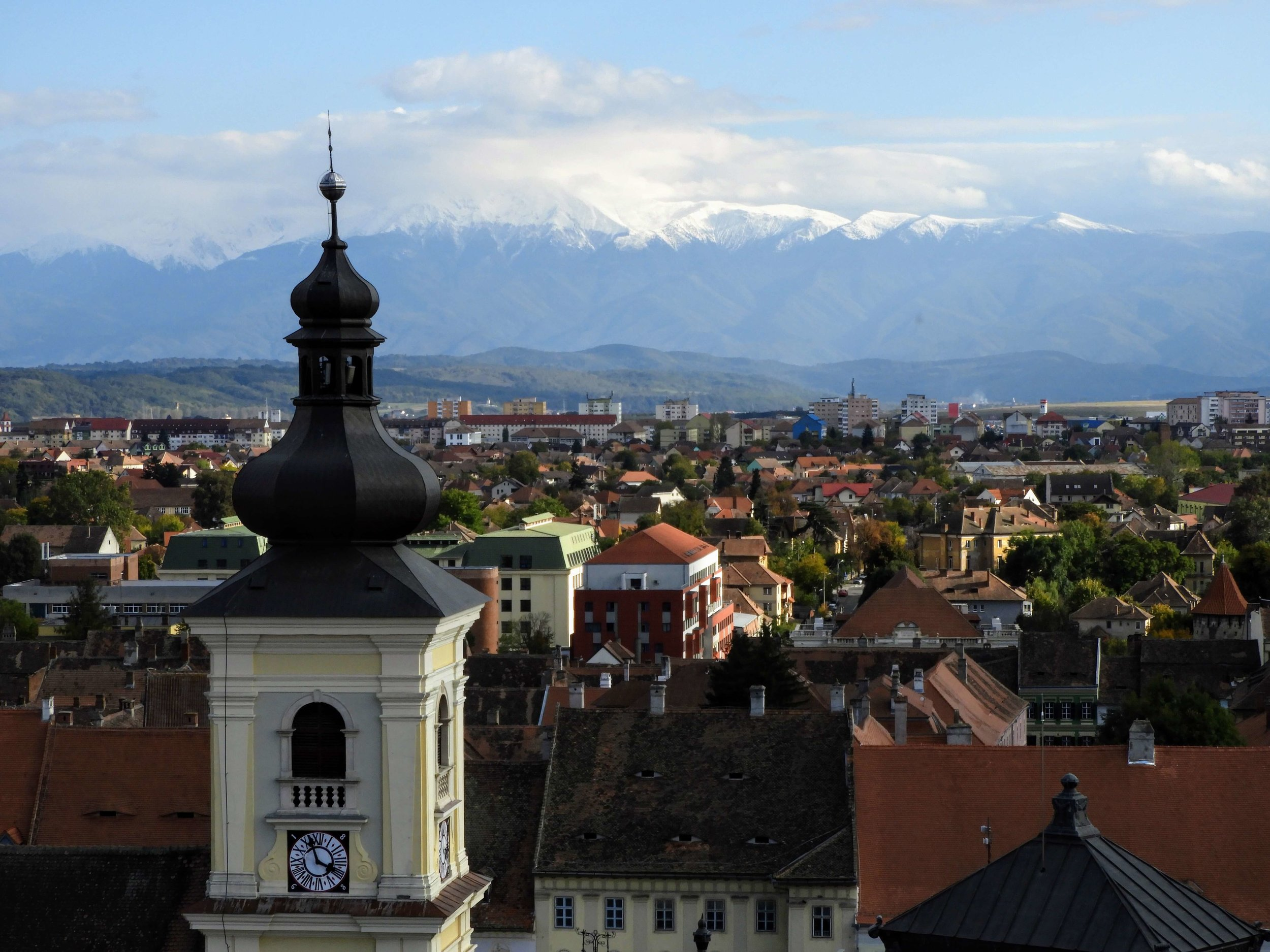 romania-sibiu-church-tower-mountains-snow.JPG