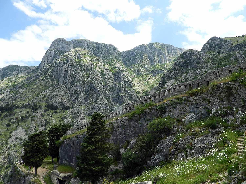 montenegro-kotor-green-mountains-cypress-trees-san-giovanni-fortress.jpg