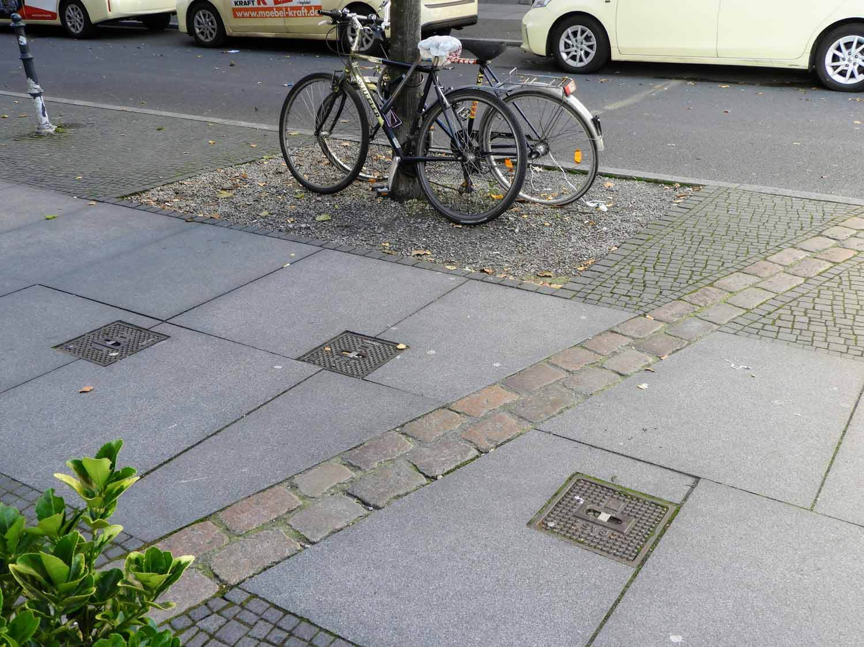 germany-berlin-wall-cold-war-soviet-union-west-vs-east-stone-marking-bikes.jpg
