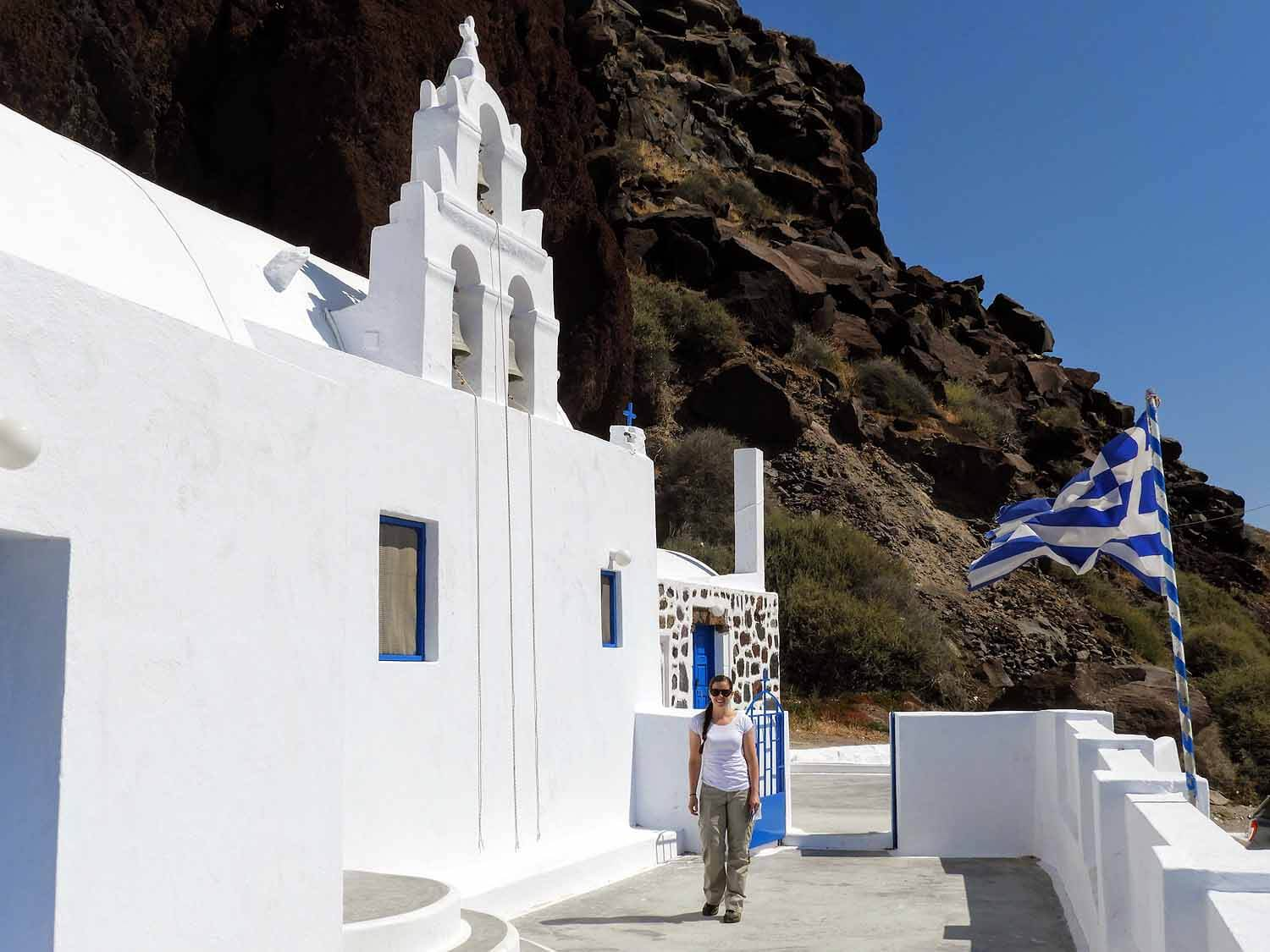 greece-santorini-red-orthadox-church-beach-greek-flag.jpg