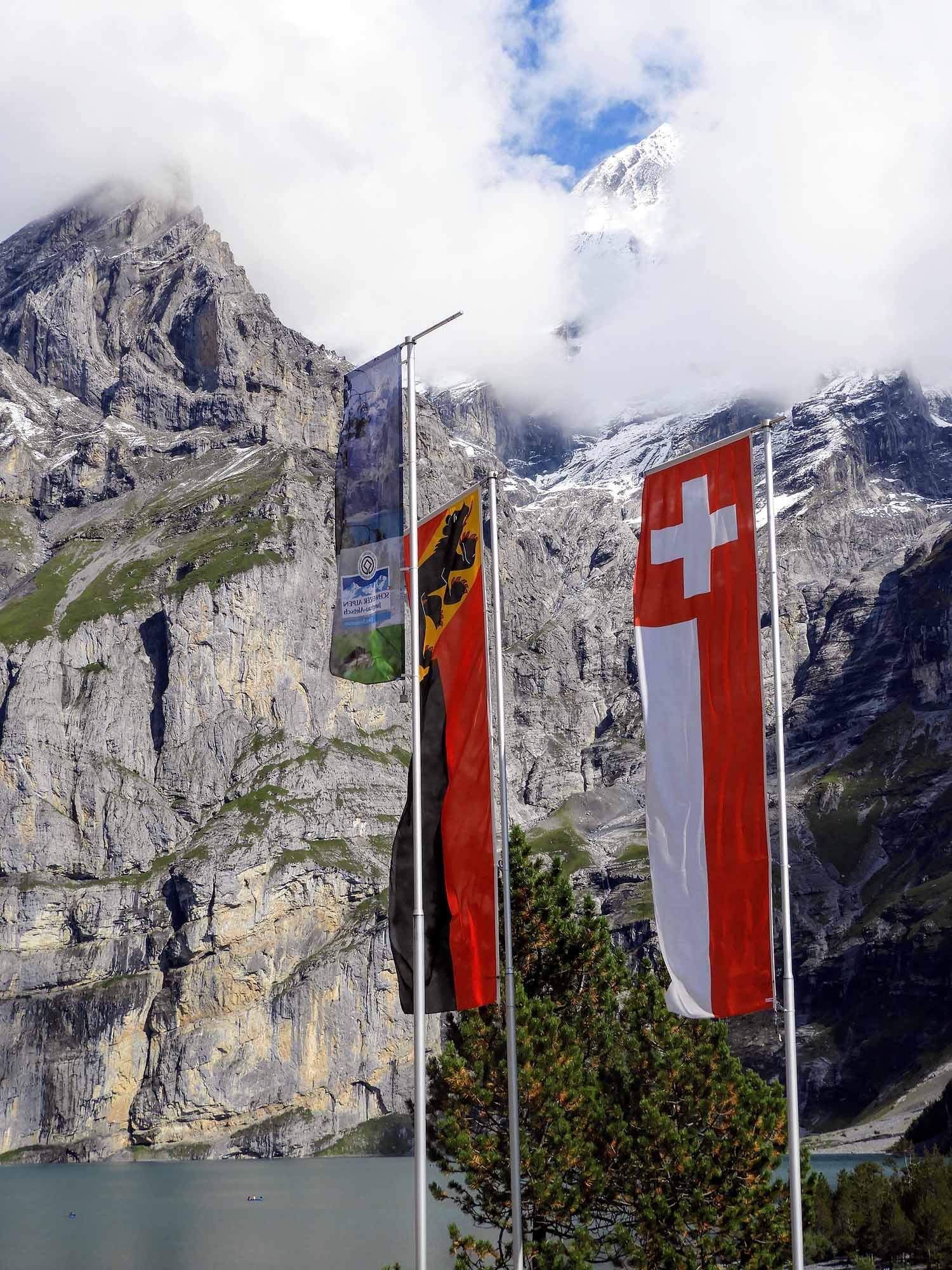 switzerland-oeschinensee-swiss-flags.jpg