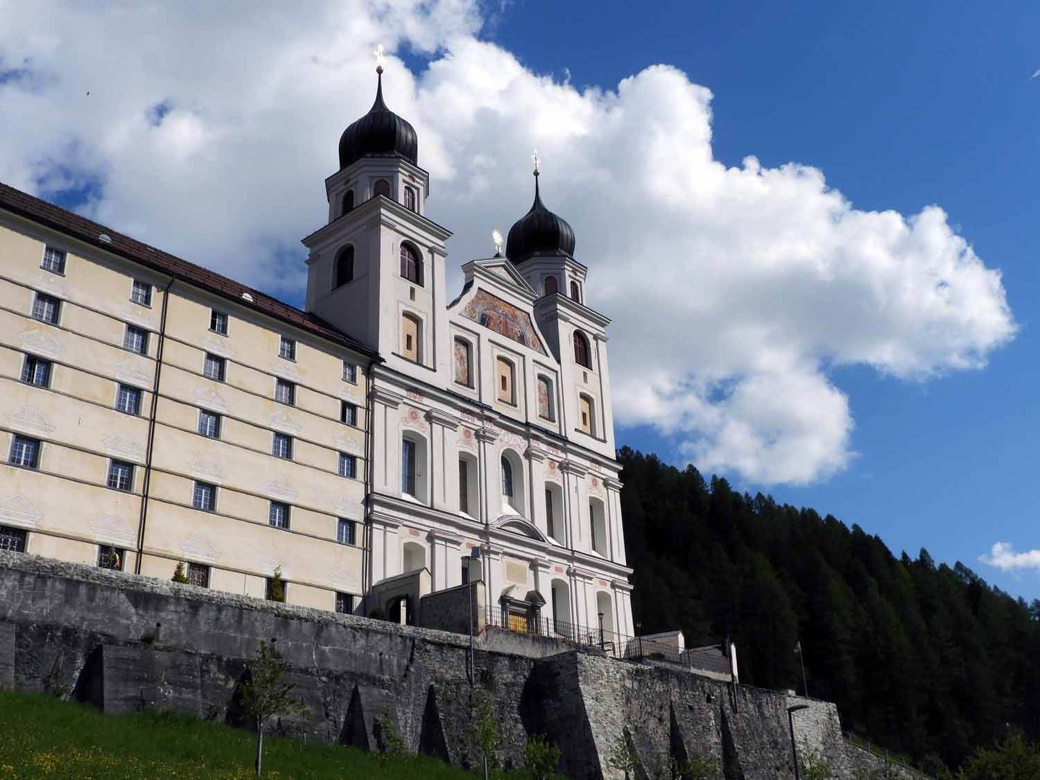 switzerland-oberalppass-vorderrhein-river-valley-monestary-kloster-disentis-clouds-blue-sky.JPG