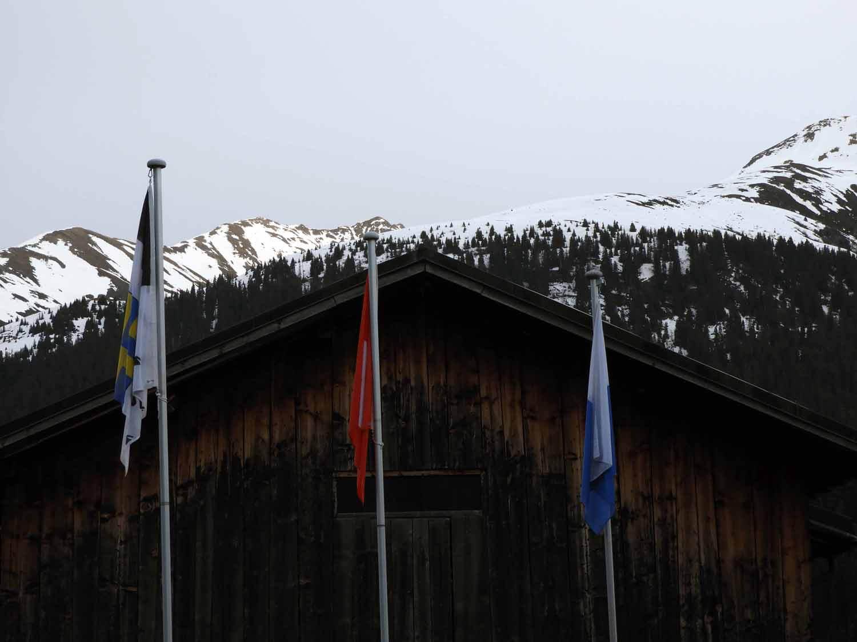 switzerland-oberalppass-vorderrhein-river-valley-flags.JPG