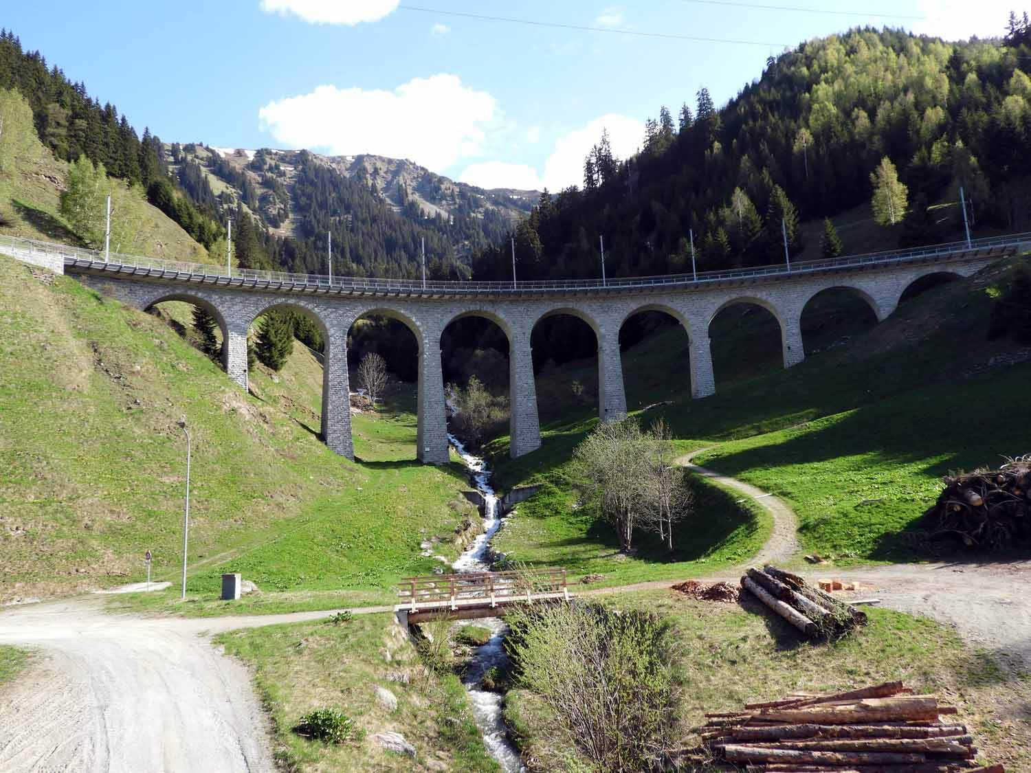 switzerland-oberalppass-vorderrhein-river-valley-stone-train-bridge.JPG