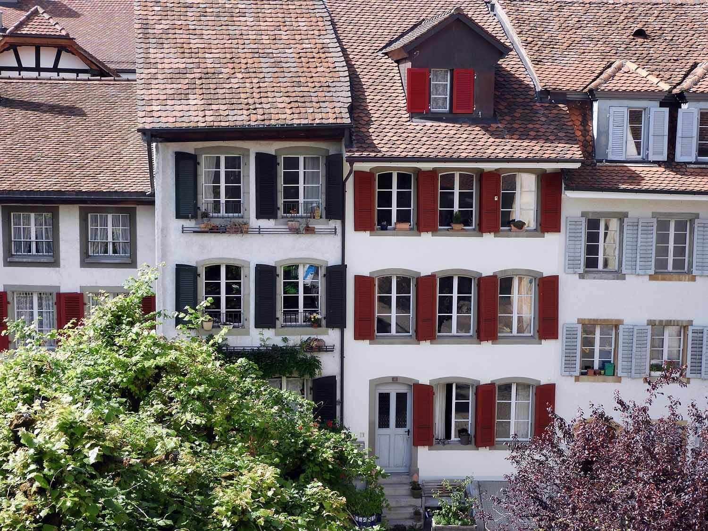 switzerland-murten-colorful-shutters.JPG