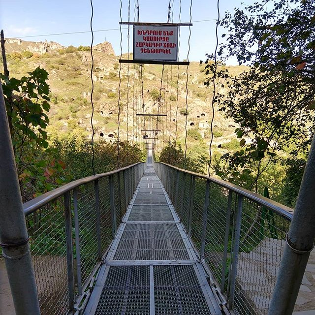Cross the #swingingbridge to explore the cave city of #khndzoresk (Note: first time we've actually felt uneasy in the Caucasus)  These caves date back to the 17th century and were home to 1800 households up until the 1950s. The community was complete with schools, shops, tanneries and churches.  #maiastratravel #maiastra #maiastralife #armenia #caucasus #cave